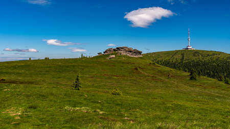 Petrovy kameny rocks and Praded hill with communication tower in Jeseniky mountains in Czech republic