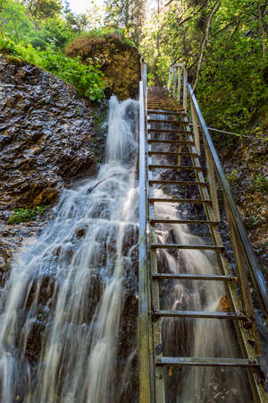 Highest part of Janosikove diery named Tesna rizna in Mala Fatra mountains in Slovakia with ladder and waterfall Reklamní fotografie