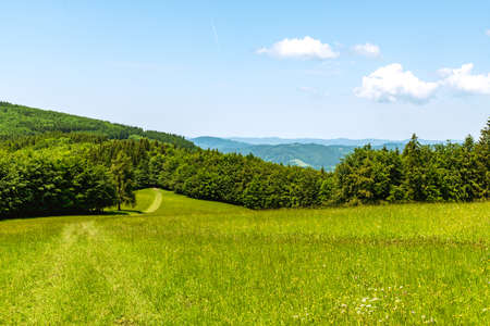 Springtime Bile Karpaty mountains scenery with mix of meadows, forest and hills on czech - slovakian borders bellow Kosak hill