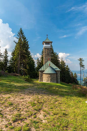 Kaple sv. Anny chapel with view tower on Kozubova hill in Moravskoslezske Beskydy mountains in Czech republic during summer evening
