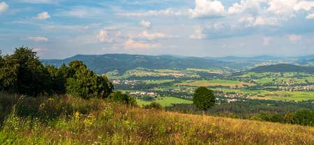 View from Mala Kycera hill in Moravskoslezske Beskydy mountains near Jablunkov town in Czech republic during summer evening