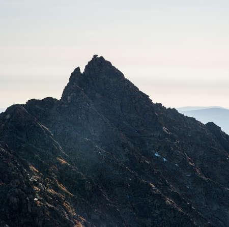 Koncista mountain peak with Nakova rock formation on summit in autumn Vysoke Tatry mountains in Slovakia