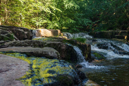 Mumlava river with series of cascades and stones above Harrachov in Krkonose mountains in Czech republic