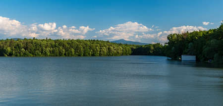 Zemanice water reservoir with Lysa hora hill in Moravskoslezske Beskydy mountains on the background in Czech republic