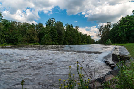 Wild Ostravice river with forest around near Ostrava city in Czech republic after few days of heavy rains