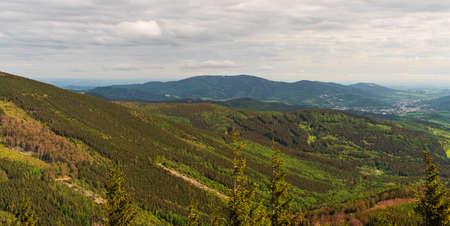 View to Jesenik town and Rychlebske hory mountains from Tocnik hill above Bela pod Pradedem in Jeseniky mountains in Czech republic Reklamní fotografie