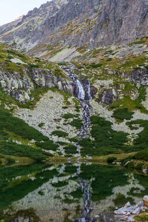 Velicky vodopad waterfall with Velicke pleso lake in Velicka dolina valley near Sliezsky dom in Vysoke Tatry mountains in Slovakia