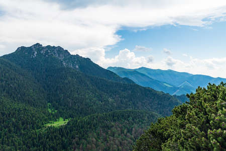 View from Maly Rozsutec hill in Mala Fatra mountains in Slovakia with rocky Velky Rozsutec hill and other hills of Mala Fatra mountains