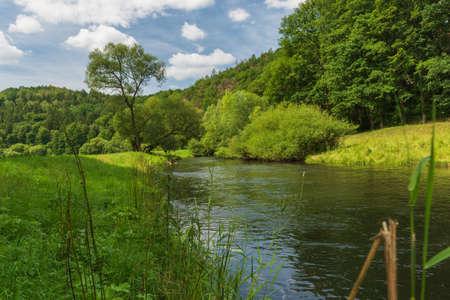 Weisse Elster river with meadow and trees around near Elstertalbrucke bridge in German Reklamní fotografie