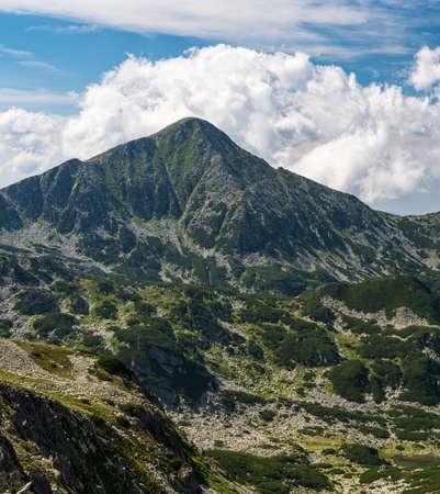 Retezat mountain peak from hiking trail bellow Peleaga mountain peak near Saua Custura Bucurei saddle in Retezat mountains in Romania