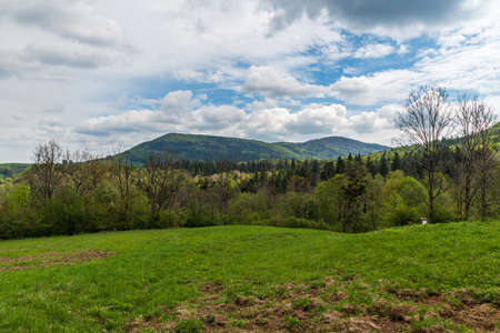 Czantoria Mala and Velka Cantoryje hills from meadow bellow Vruzna hill in Slezske Beskydy mountains on czech - polish borders during springtime day