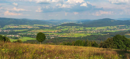 View from Mala Kycera hill in Moravskoslezske Beskydy mountains in Czech republic with rural landscape and hills