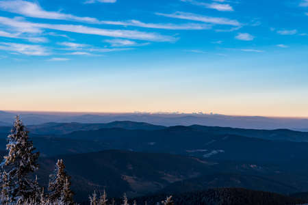 View to Tatra mountains from Lysa hora hill in Moravskoslezske Beskydy mountains in Czech republic during late autumn sunset Reklamní fotografie