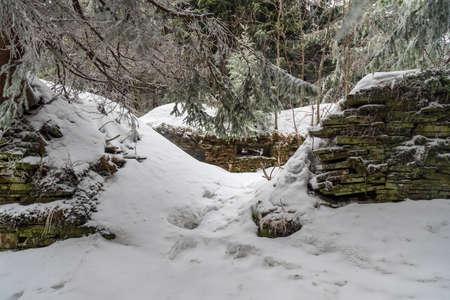 Ruins of abandoned house bellow Certuv mlyn hill in winterMoravskoslezske Beskydy mountains in Czech republic