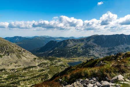 View from Custura Bucurei mountain peak above Bucura lake in Retezat mountains in Romania