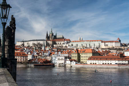 Prague Castle with Mala Strana and Vltava river from Charles Bridge in Prague city in Czech republic during beautiful late autumn day Reklamní fotografie