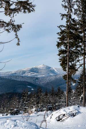 Lysa hora hill from forest glade near Okrouhlice hill summit above Moravka village in winter Moravskoslezske Beskydy mountains in Czech republic
