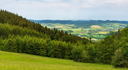 Valasske Prikazy and Studlov village with hilly surrounding from meadow bellow Pozar hill summit in Bile Karpaty mountains in Czech republic