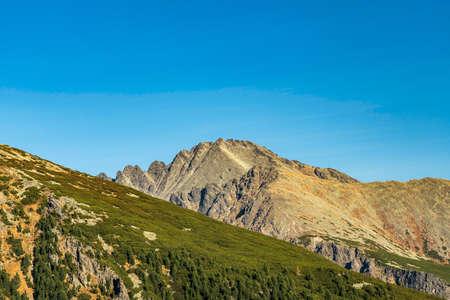 Autumn Vysoke Tatry mountains - part of Hreben Bast mountain ridge above Mlynicka dolina valley from hiking trail bellow Chata pod Soliskom in Slovakia