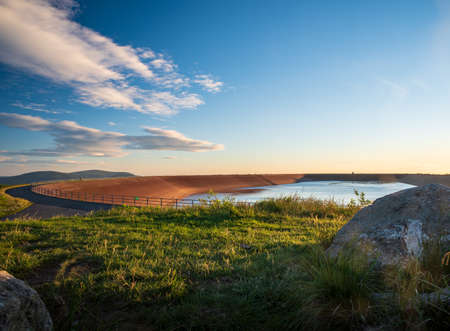 Elevated reservoir of Dlouhe Strane hydro power plant with hills on the background in Jeseniky mountains in Czech republic during summer morning Reklamní fotografie