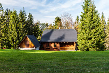 Wooden cotage on meadow with trees around in Moravskoslezske Beskydy mountains in Czech republic
