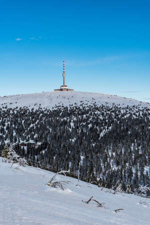 Praded hill with communication tower in winter Jeseniky mountains in Czech republic