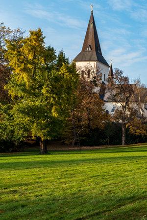 Kostel Povyseni sv. Krize church from Park Bozeny Nemcove public park in Karvina city in Czech republic during beautiful autumn day Reklamní fotografie