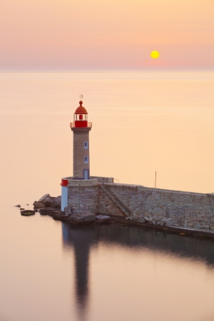 Lighthouse in sunrise, Bastia port, Corsica, france photo