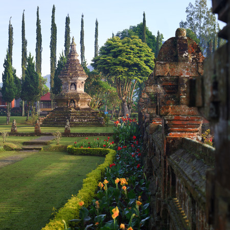 Buddhist stupa in gardens of Pura Ulun Danu temple on a lake Bratan, Bali, Indonesia photo