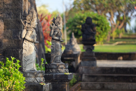 vihara: hindu sculptures close to entrance to buddhist temple Brahma Vihara-Arama Banjar Bali, Indonesia, small version of Borobudur temple on Java Stock Photo