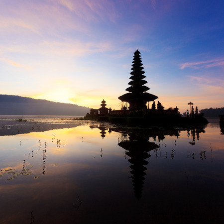 Pura Ulun Danu temple silhouette before sunrise on a lake Bratan. Bali, Indonesia