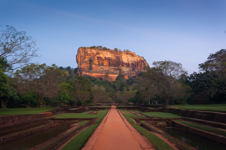lions rock: Sigiriya. Lions rock at sunset, Place with a large stone and ancient rock fortress and palace ruin. Srilanka, Asia Stock Photo