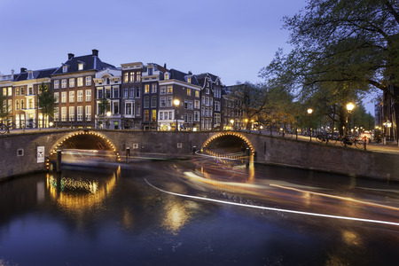 amstel river: Beautiful Amsterdam canals with bridge and typical dutch houses. Holland, Netherlands, Europe