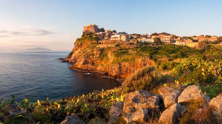 capraia: Panorama of Capraia city on the rock of Isola di Capraia island at sunrise, Tuscany, Italy, Europe