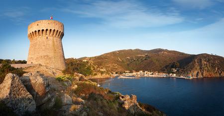 capraia: Panorama of Capraia harbour, rocks and yacht in bay on Capraia island, Elba, Tuscany, Italy, Europe