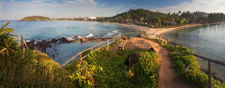 Panorama of tropical beach in the town of Mirissa, Sri Lanka, Asia