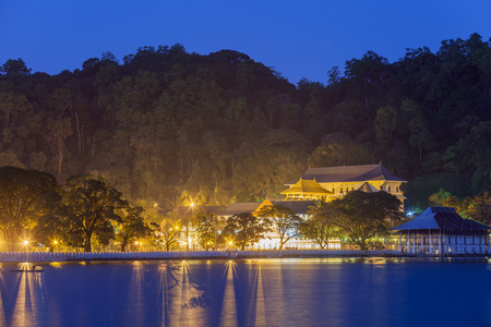 pada: Night view of the Temple of the Buddha Tooth with a lake and lights. Kandy, Sri Lanka, Asia.