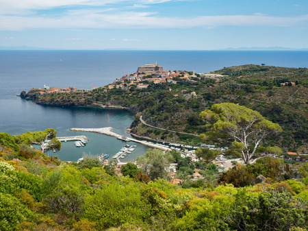 capraia: Panoramic view of Capraia town and harbour with Elba in background, Tuscany, Italy, Europe