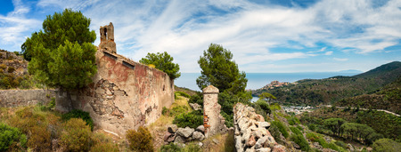 capraia: Panorama from old church on beautiful Capraia island with town and harbour and Elba in background, Tuscany, Italy, Europe