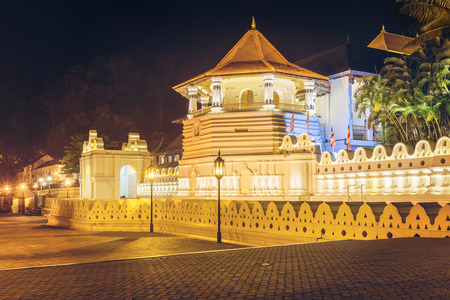 relics: Night view of the Temple of the Buddha Tooth with lights. Kandy, Sri Lanka, Asia. Stock Photo