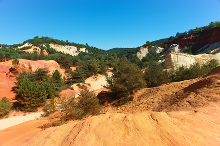 ochre: Colored red and yellow ochre mountains and quarries in Rousillon. Provence, France.