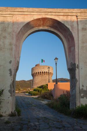 capraia: Old Tower and gate at sunrise on Capraia island, Elba, Tuscany, Italy, Europe