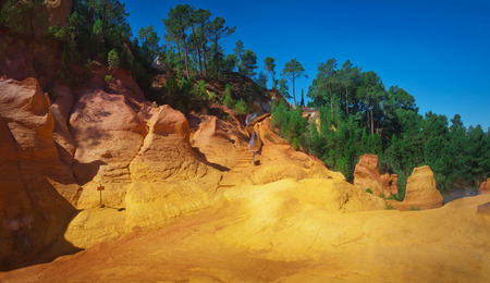luberon: Panoramic view of famous red clifs of colored orche mountai in Roussillon Vaucluse, Luberon, Provence, France