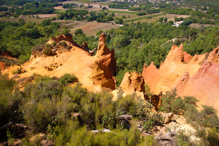 ochre: Famous colored red and yellow ochre mountains and quarries in Rousillon. Provence, France.