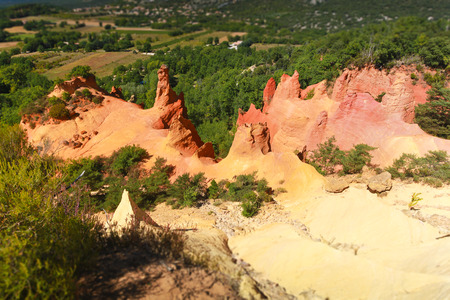 yellow ochre: Famous colored red and yellow ochre mountains and quarries in Rousillon. Provence, France.