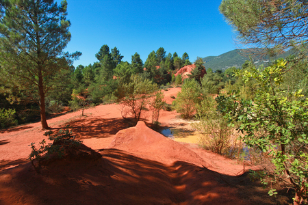 vaucluse: Famous red clifs with tree of Roussillon and ochre quarries Vaucluse, Luberon, Provence, France Stock Photo