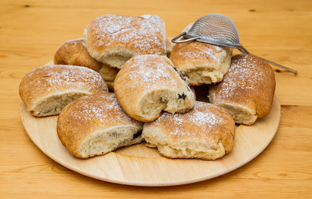 sifter: Poppy seed buns on plate