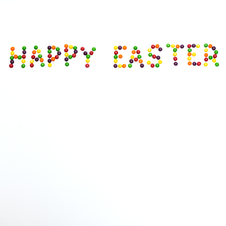 easter sign: Happy Easter sign made of colour lentil candies