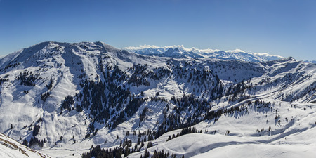clean environment: Winter snowy mountains panorama. Concept of untouched nature and clean environment. Stock Photo