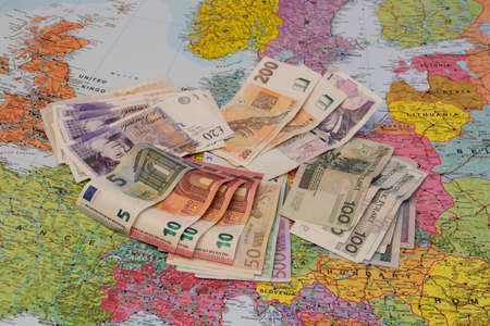 divergence: Four different currencies laid out on Europe. Concept of Europe divergences or different currencies or traveling in European countries.